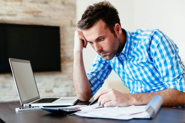 Man completing bills