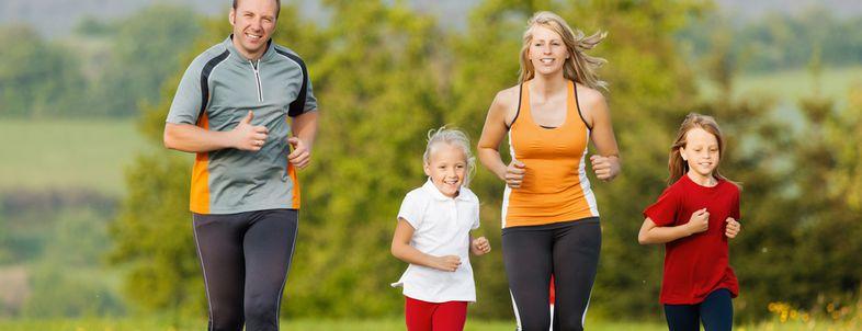Family running for sport outdoors