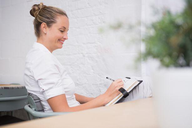 Businesswoman writing to do list