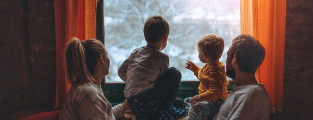 family looking at the snow in the winter