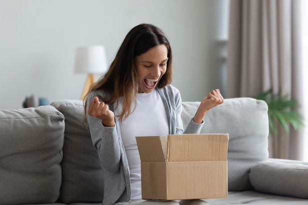 Woman opening delivery