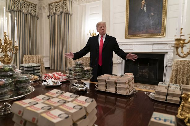 U.S President Donald Trump presents fast food to be served to the Clemson Tigers football team to celebrate their Championship at the White House