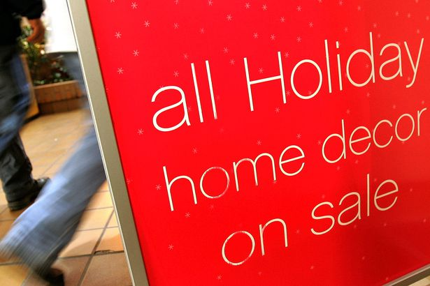 sale sign for 'Holiday home decor' merchandise is displayed near the entrance of a Sears