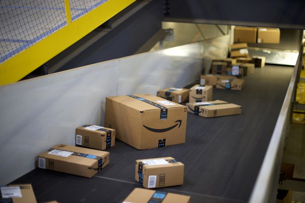 boxes travel on conveyor belts at the Amazon Fulfillment Center