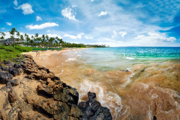 tourists and visitors visiting the beautiful white sand beach of Wailea