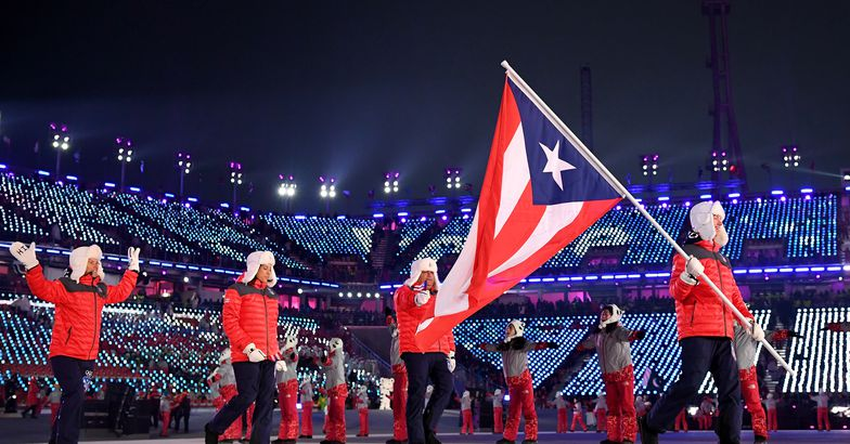 flag bearer charles flaherty of puerto rico and teammates arrive at the stadium during the opening ceremony of the pyeongchang 2018 winter olympic games at pyeongchang olympic stadium on february 9, 2018 in pyeongchang-gun, south korea