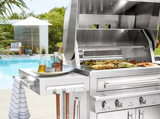 Outdoor gas grill next to a pool