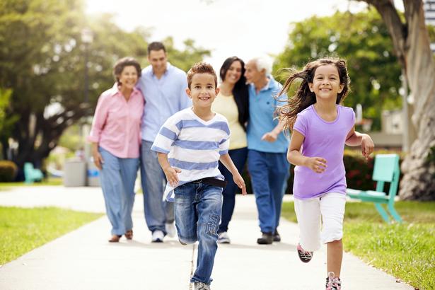 Happy multi-generational family taking a walk