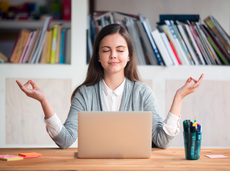 Woman meditating and being mindful at work