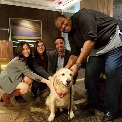Kimpton hotel employees with a dog