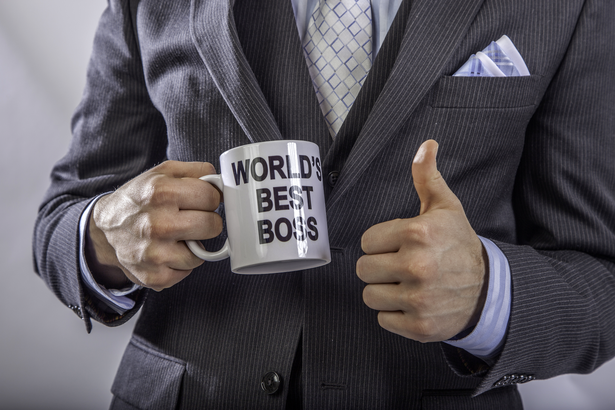 Boss holding World's Best Boss mug