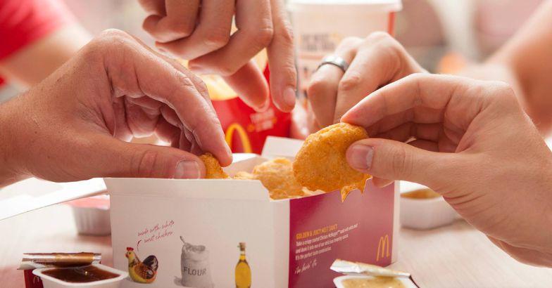 Friends sharing McDonald's Mcnuggets