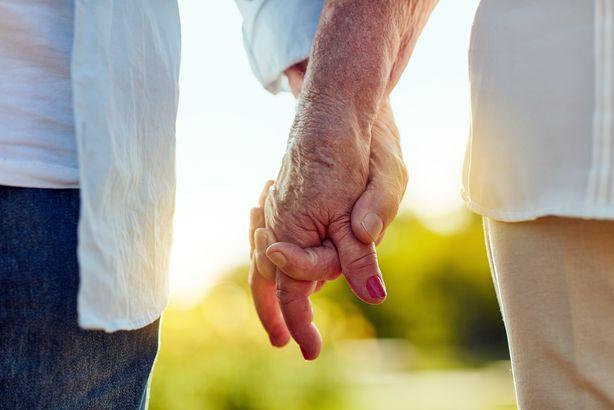 Closeup of seniors holding hands