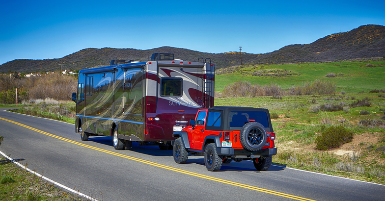 RV towing a Jeep