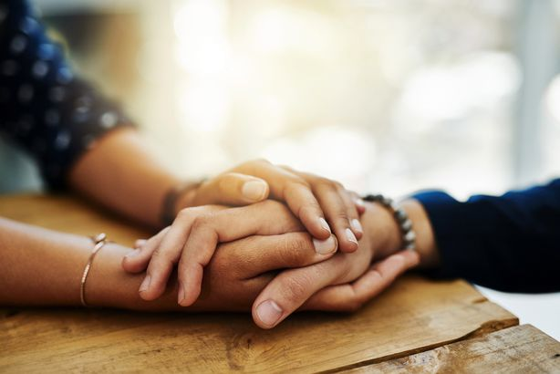 Close-up of holding hands to console