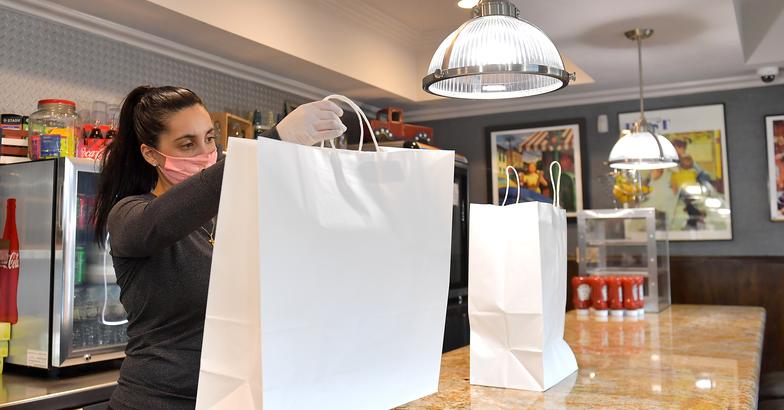 Marlboro Diner owner Kara Petrou wears a mask preparing Passover meals for pickup