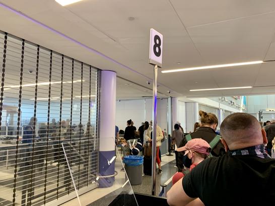 A crowded TSA checkpoint line in EWR