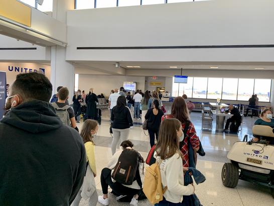 A line to board a plane to Orlando, Florida at EWR