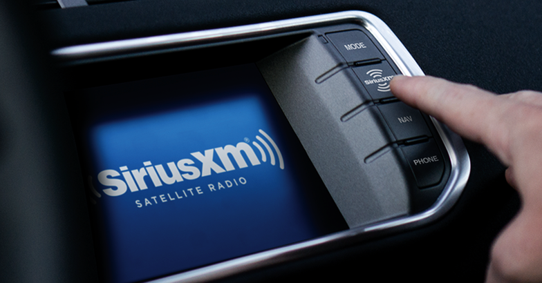 siriusxm radio, finger pressing screen in vehicle