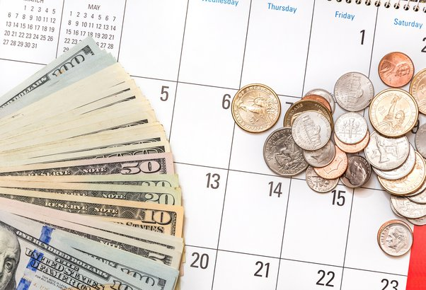 Calendar with dollar bills and coins