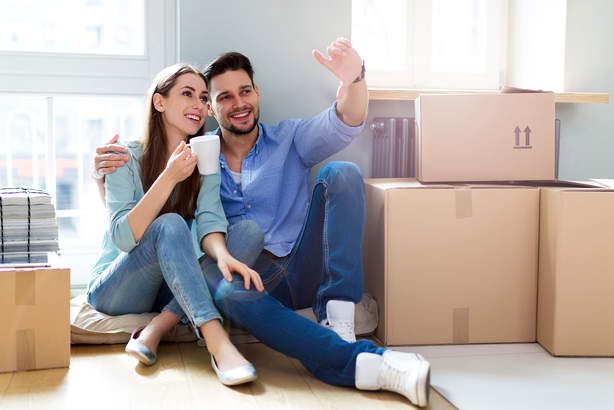 Couple moving into new house deciding where to put things