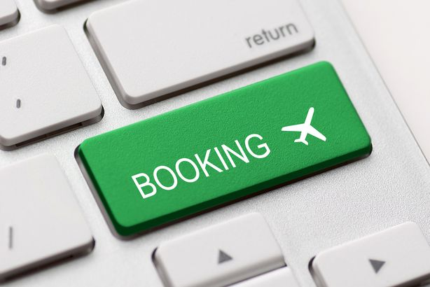 Flight booking button on a keyboard