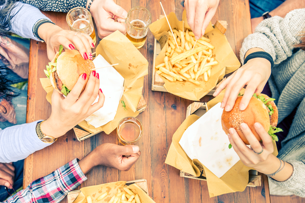 Aerial view of people at a table with burgers and fries