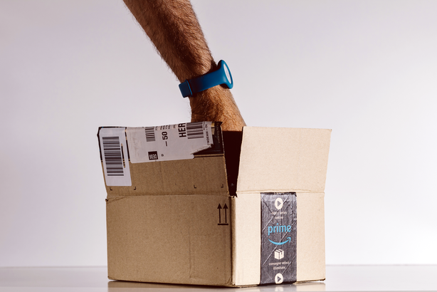Man's hand reaching into an Amazon Prime box