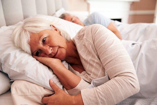 Senior woman awake in bed