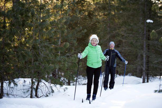 Senior couple cross country skiing