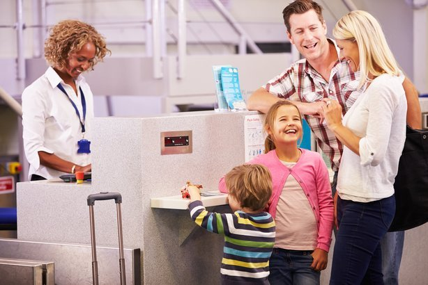 family checking in at an airport check-in