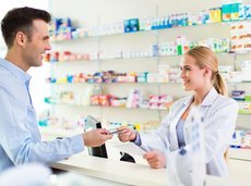 customer and pharmacist at pharmacy counter