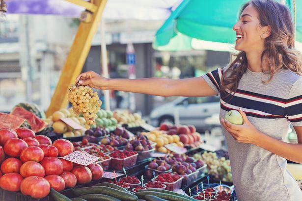 buying grapes at a market