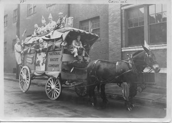 Carnival group riding on a National Biscuit Company cart