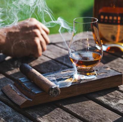 Cigar holder and whiskey coaster