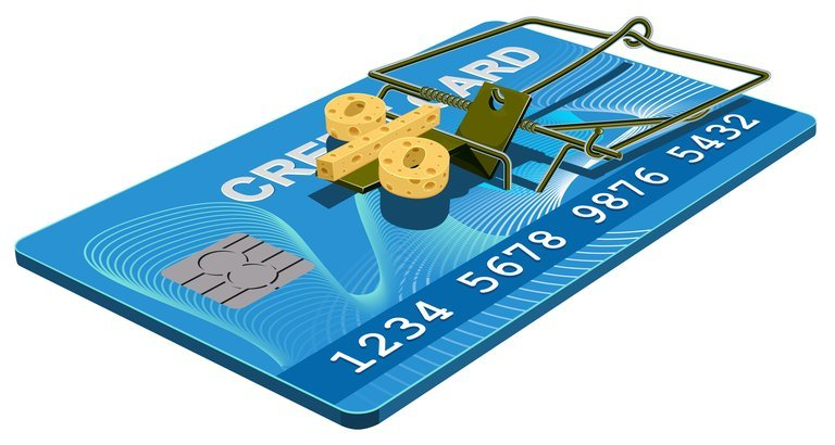 image of a credit card with % sign as the bait inside of a mouse trap