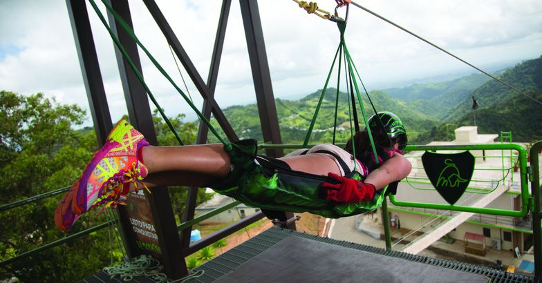 woman strapped into el monstruo zipline about to descent