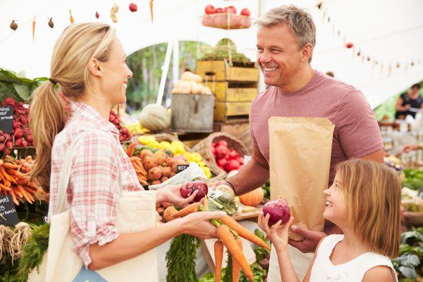 family choosing veggies