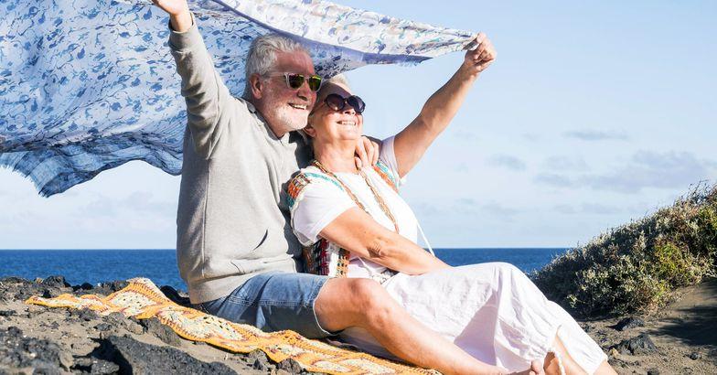 senior couple on beach smiling