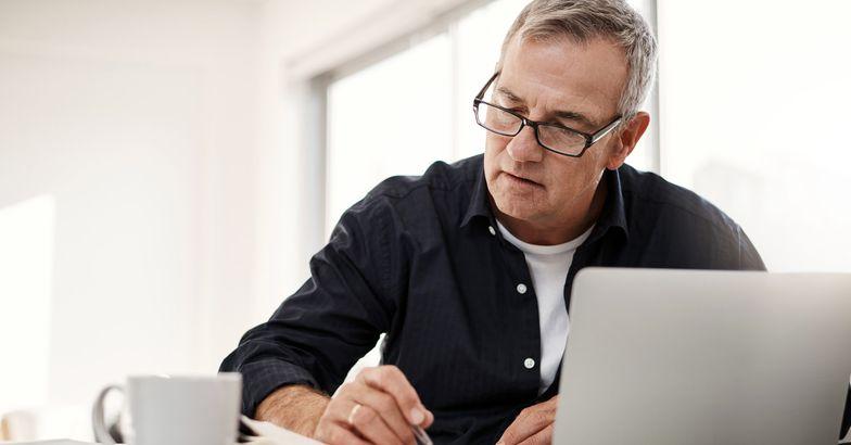 senior man doing calculations