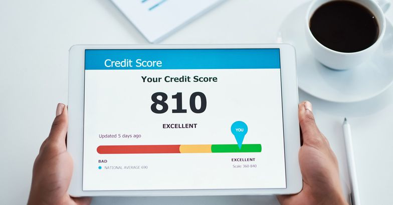 hands holding tablet with credit score open