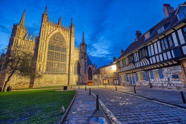 The backside of the York Minster and some half-timbered houses