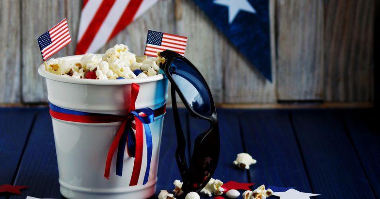 popcorn in bucket with patriotic decorations, sunglasses