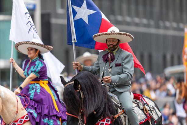 Vaquero with Texas flag