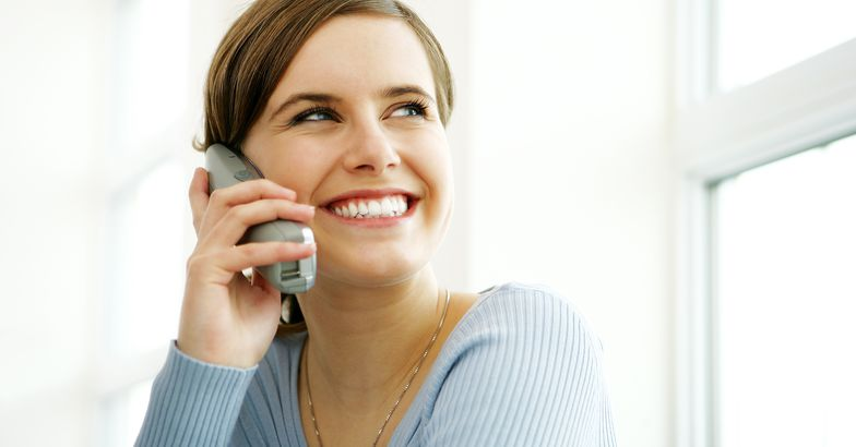 young woman on cordless phone