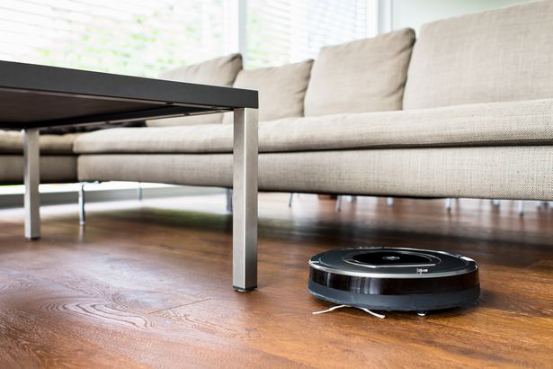 robot vacuum cleaner cleaning living room