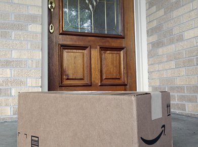 Amazon.com package at front door of house