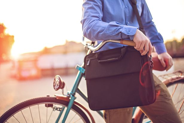 hipster businessman on bike with laptop bag