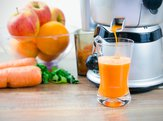 fruits being juiced by juicer