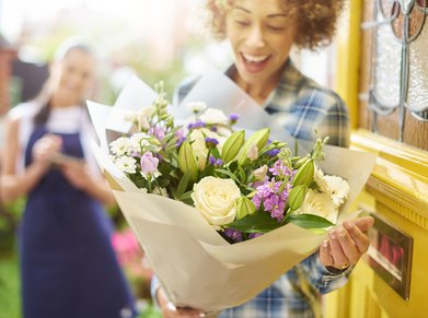 woman getting flower delivery at her door